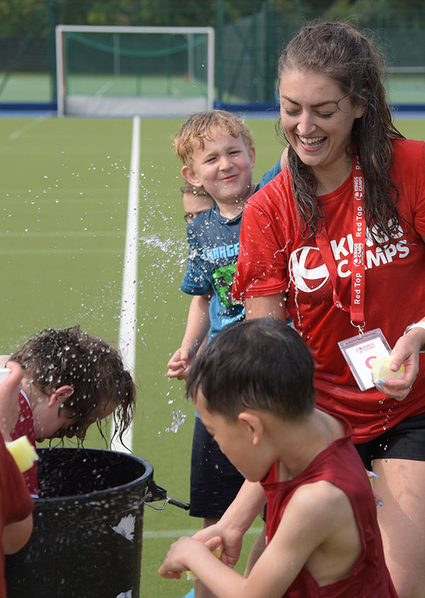 a red top and children enjoying wet wednesdays activities