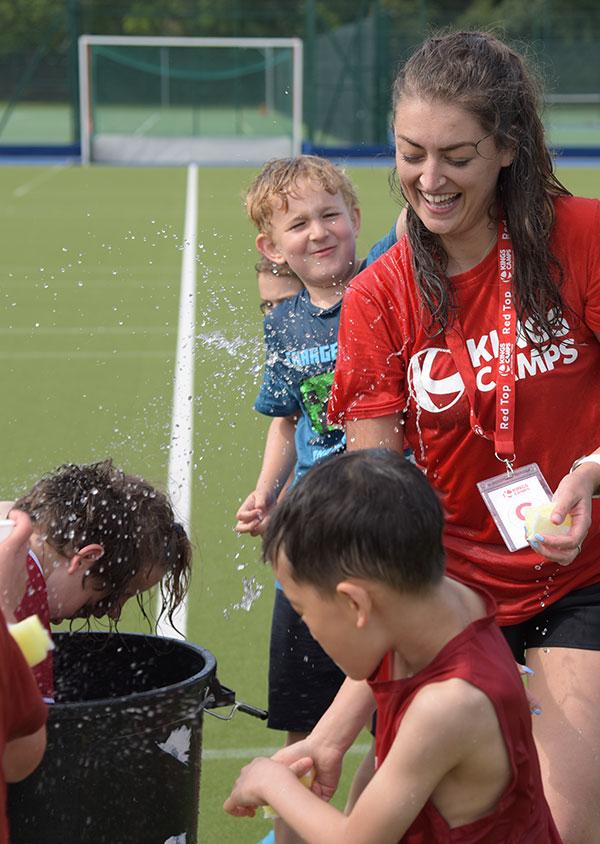 a red top and children enjoying wet wednesdays activities