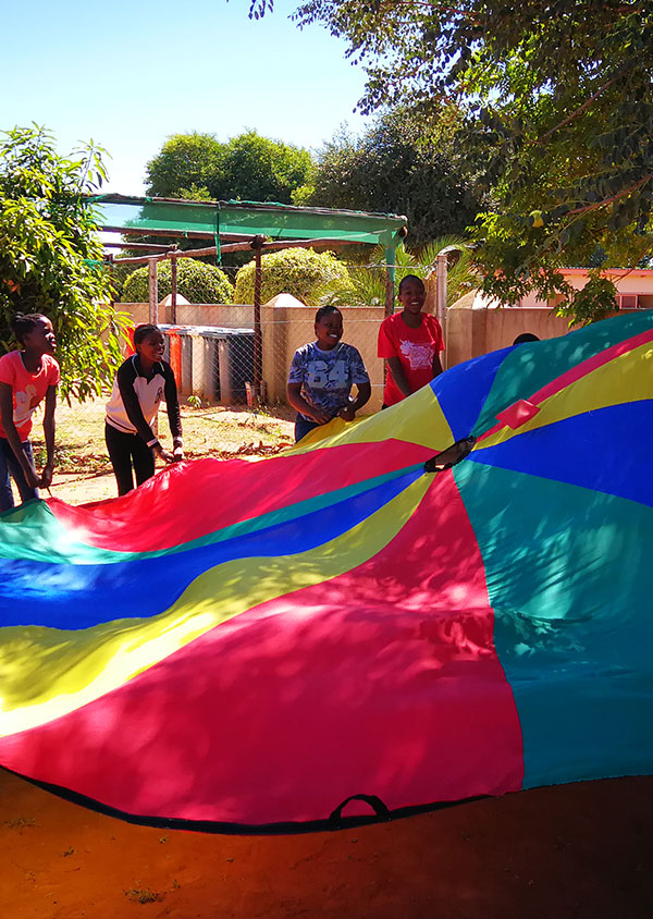 children enjoying parachute games