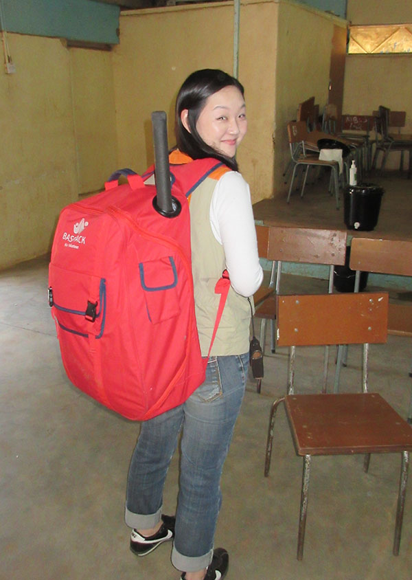 a person with the basepack on her back