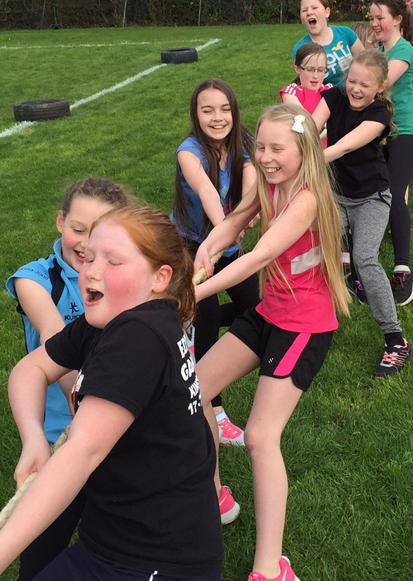 children taking part in a game of tug of war