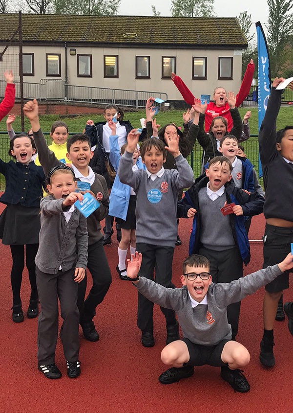 school children celebrating