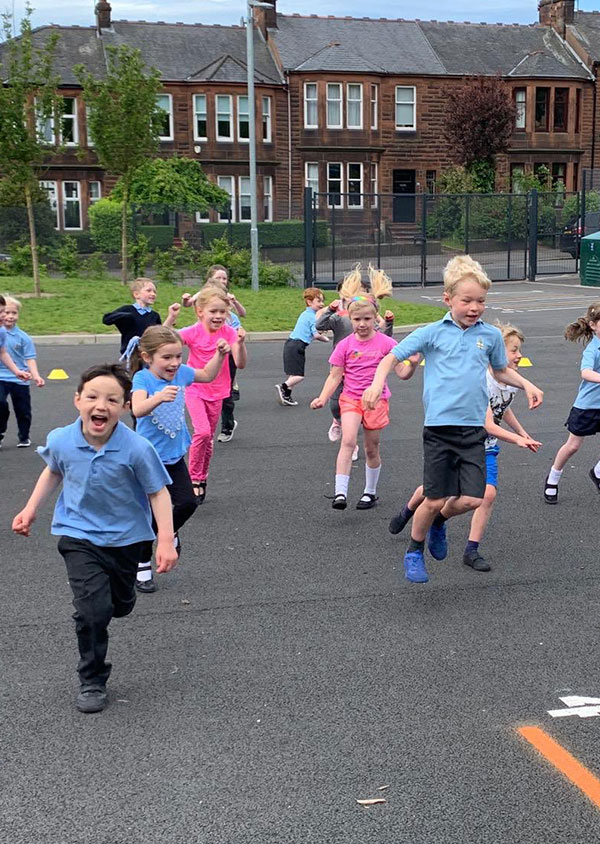 children running and jumping in the air