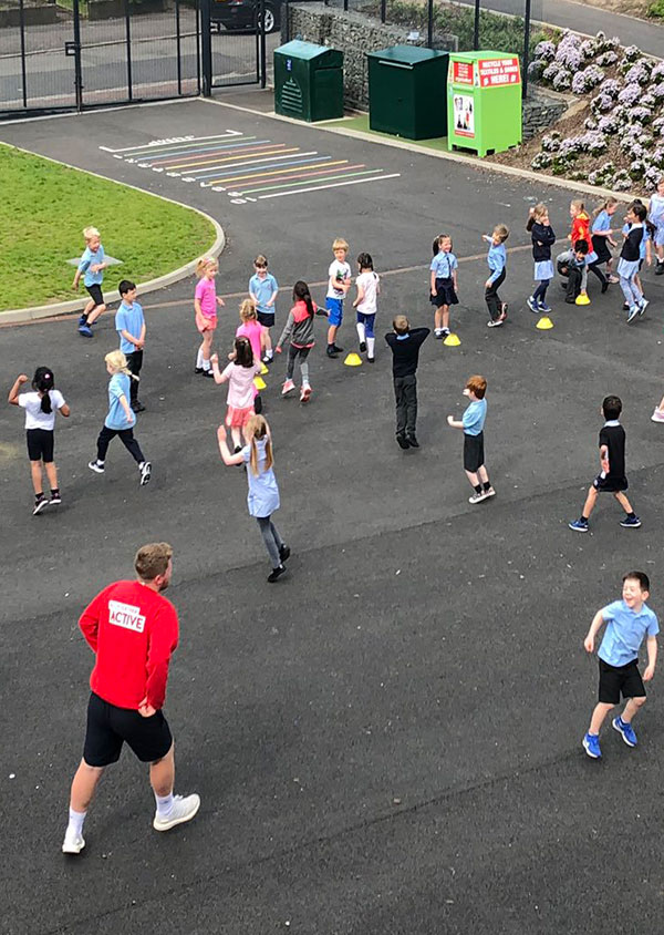 children being active outside in the playground