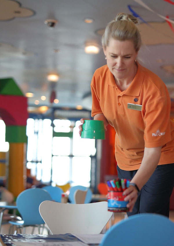 cruise and resort staff setting up activities