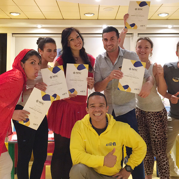 a group of staff with their certificates