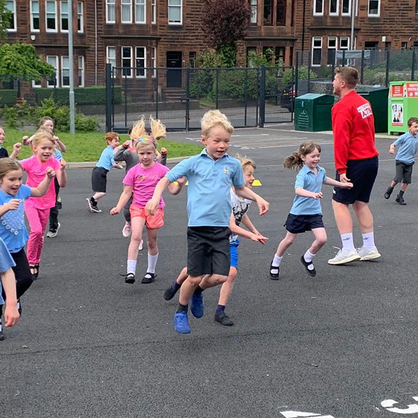 School childrden taking part in sports activities in the playground